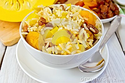 Pilaf fruit with pumpkin, raisins, dried apricots in a bowl on a ...