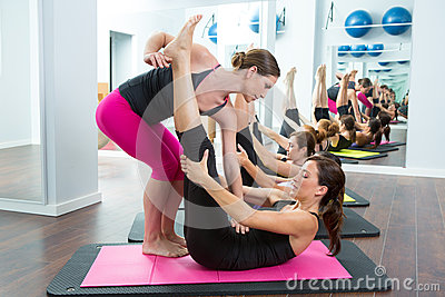 Pilates personal trainer helping women