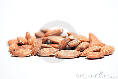 Pile of almonds on isolated white background
