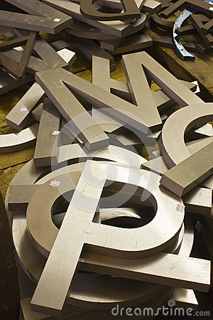 a pile of alphabet letters for sale