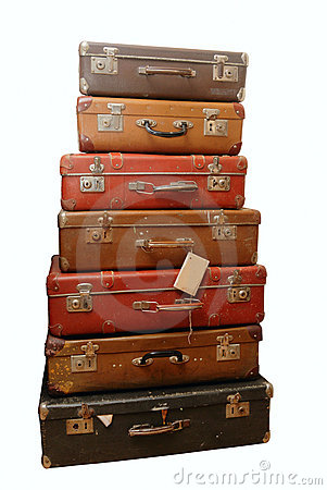 Pile of battered old suitcases