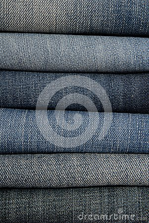 It is a close up of jeans s pile.