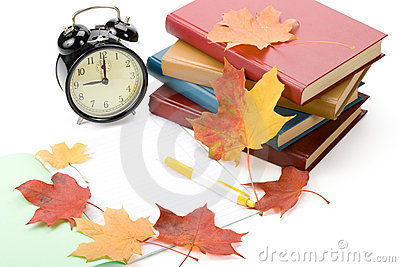 Pile of books and autumn leaves