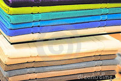 Pile of colored towels on the shelves