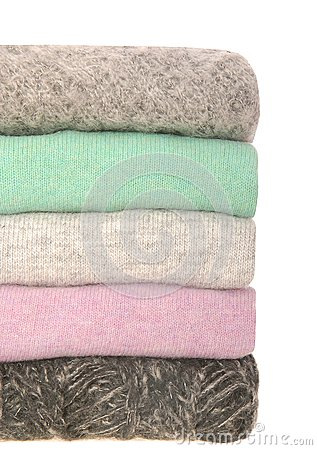 A pile of different sweaters.