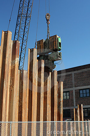 Pile Driver puts down metal pilings in preparation for new build