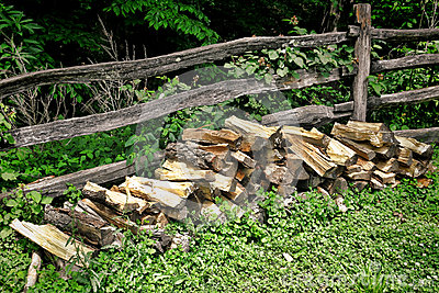 Pile of Fire Wood Split Logs and Old Rail Fence