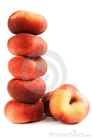 Pile of flat peaches