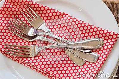 Pile of forks on napkin