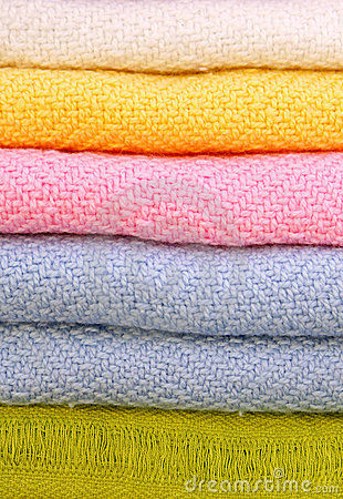 Pile of gentle folded shawls (scarfs)
