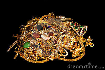 Pile Of Gold Jewelry On Black