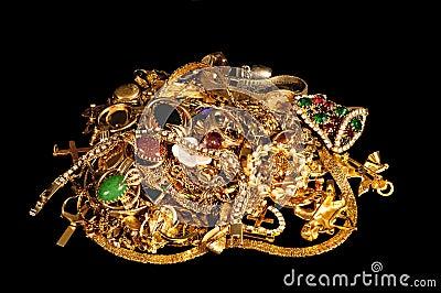 Gold jewelry on black