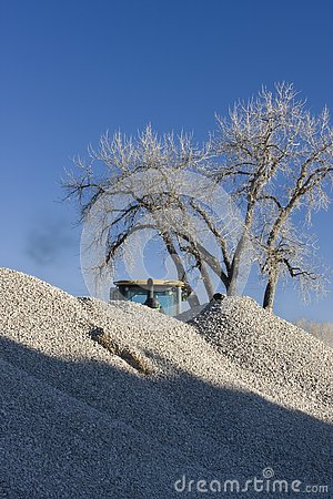 Pile of gravel at road construction with a bulldoz