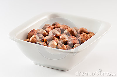 Pile of hazelnuts in a ceramic bowl