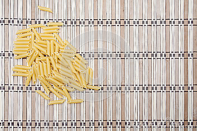 Pile of macaronion striped background