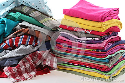 Pile of messy and ironed clothes