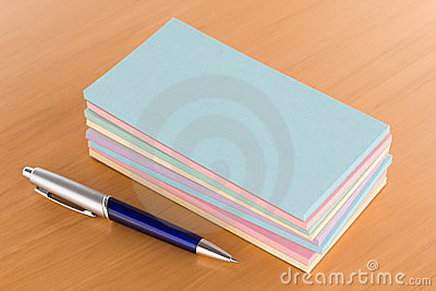 Pile of Note Pads with Pen