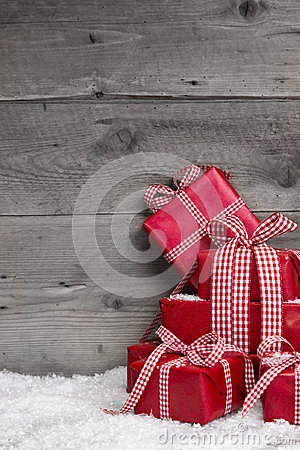 Free Pile Of Red Christmas Gifts, Snow On Grey Wooden Background. Stock Photography - 34219742