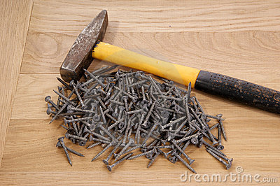 Pile of old screws and a hammer