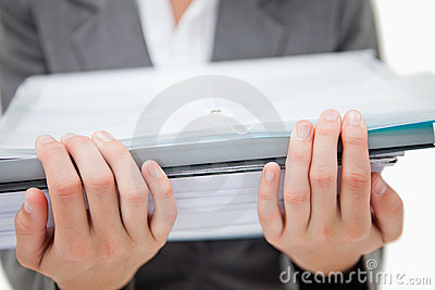 Pile of paperwork being held by female hands
