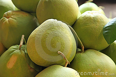 Pile of pomelo fruits