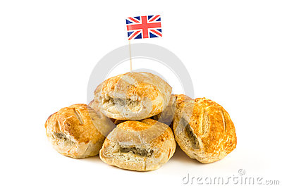 Pile of sausage rolls with union jack flag