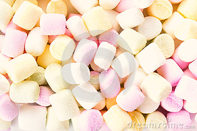 A pile of small colored puffy marshmallows may use as background