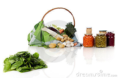 Pile of spinach, fresh and canned vegetables