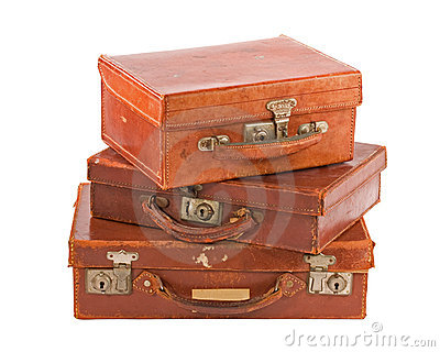 Pile of three old suitcases