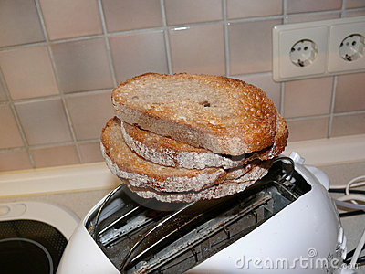 Pile of toast on toaster