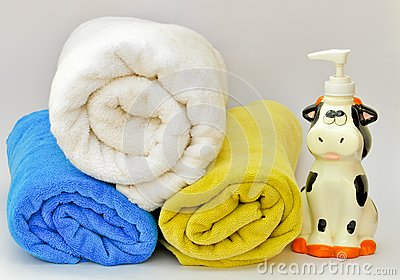 Pile of towels with a liquid soap dispenser