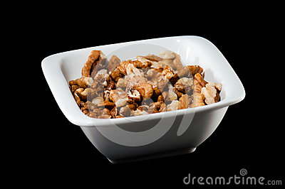 Pile of walnuts in a ceramic bowl