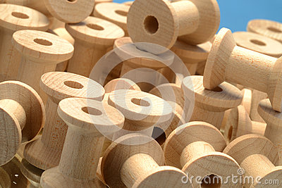 Pile of wooden bobbins