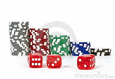 Piled poker chips with dice