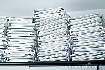 Piles of folders in office