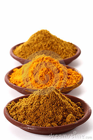 Free Piles Of Bright Curry Powder And Tumeric Stock Images - 4774784