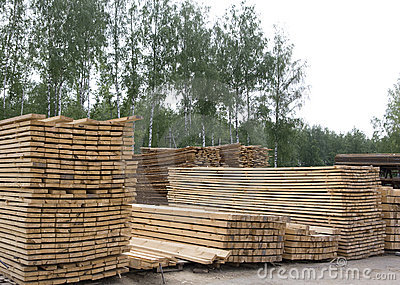Piles of pine wood planks
