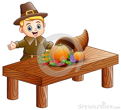 Free Pilgrim Boy With Cornucopia Of Fruits And Vegetables On Wooden Table Stock Photo - 103914740