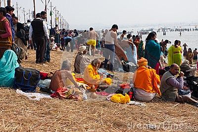 Pilgrims rest during the Kumbh Mela Editorial Stock Photo