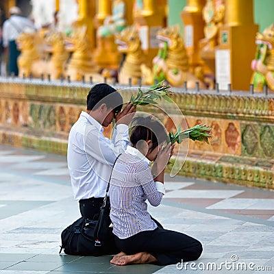 Pilgrims in the Shwedagon Paya, Myanmar Editorial Stock Photo