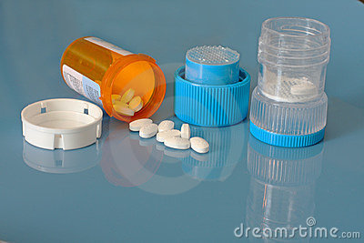 Pill crusher and prescription bottle with pills
