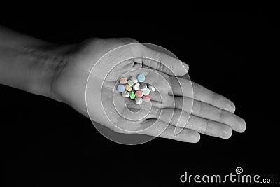 Daily Pill Regimen - Pills in Female Hand