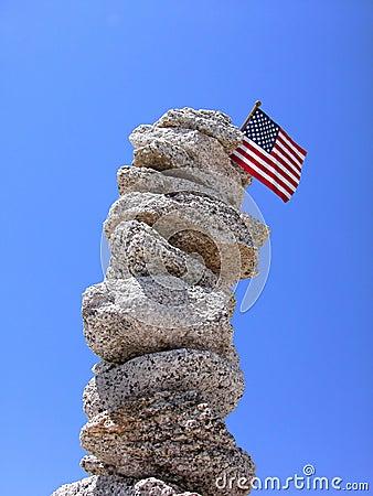 Pillar of rocks with USA flag