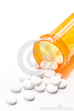 Pills with bottle on white