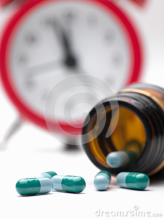 Pills and clock