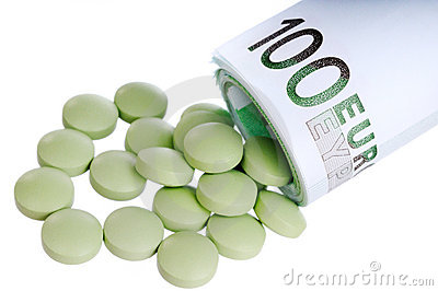 Pills fall out a sheaf of 100 euro