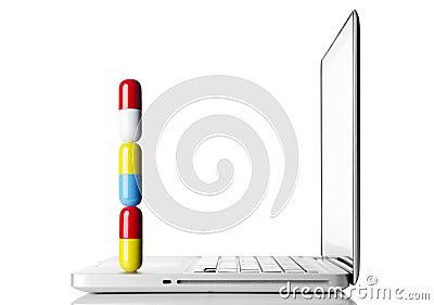 Pills on laptop