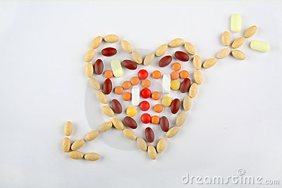 Pills in shape of love heart with arrow