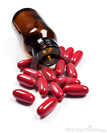 Free Pills Spilled Around A Pill Bottle Royalty Free Stock Images - 15663019