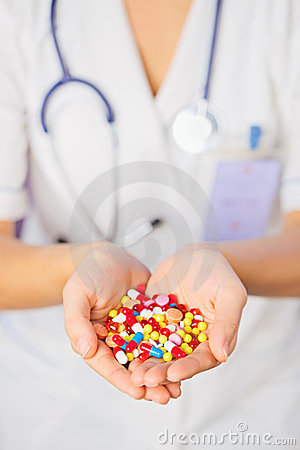 Pills, tablets and drugs heap in doctor s hand